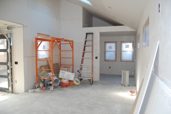 the low ceiling is over the entrance. the loft storage above will hold the mechanical for the radiant flooring